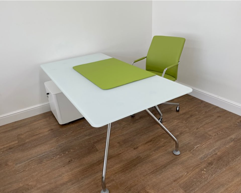 A high quality White glass modern executive desk with chrome legs and a matt white lacquered pedestal. Shown here with a lime green leather tempo executive chair and matching lime green leather desk pad.