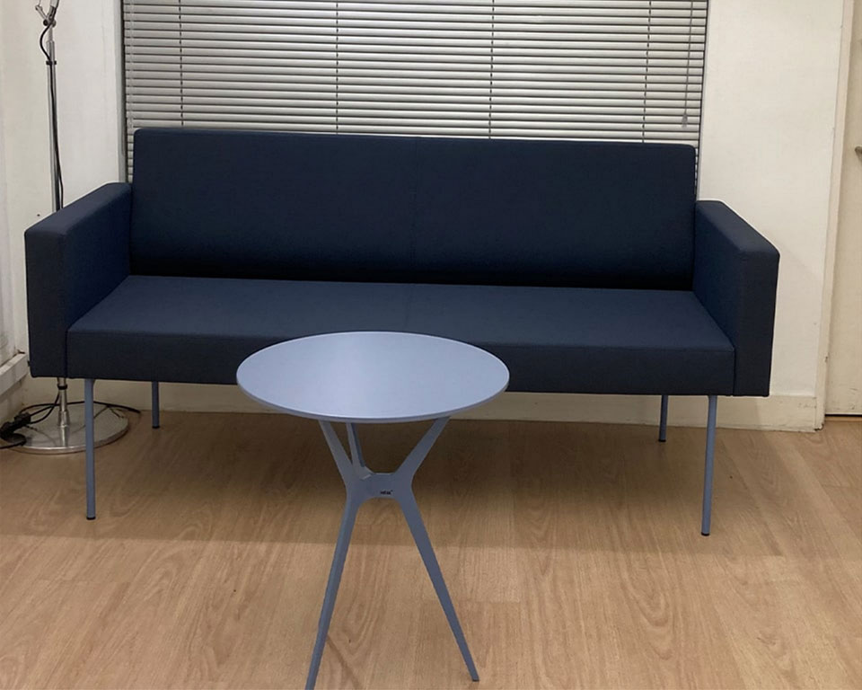 Blue two seat sofa with pale blue legs with matching Trimundo blue lacquered coffee table