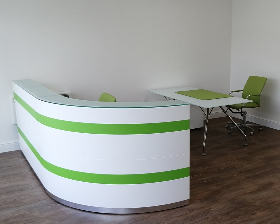 Twist is a high - end modular reception desk shown here with lime green and white horizontal bands to the vertical front panel.