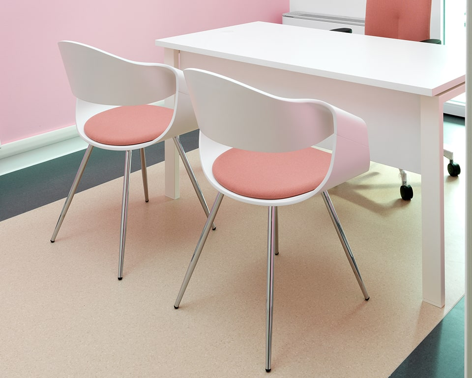 Premium quality designer visitor chairs - With white matt lacquered backs and a small upholstered seat pad with chrome legs rear view in standard white lacquered
