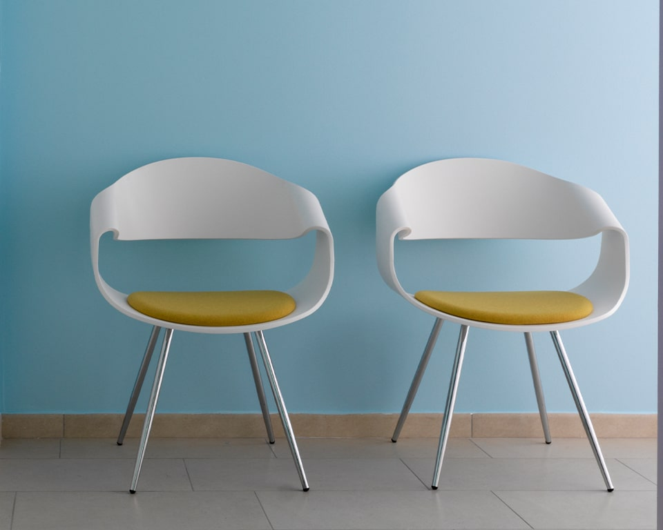 High - end designer meeting chairs - With white matt lacquered backs and a small upholstered seat pad with chrome legs