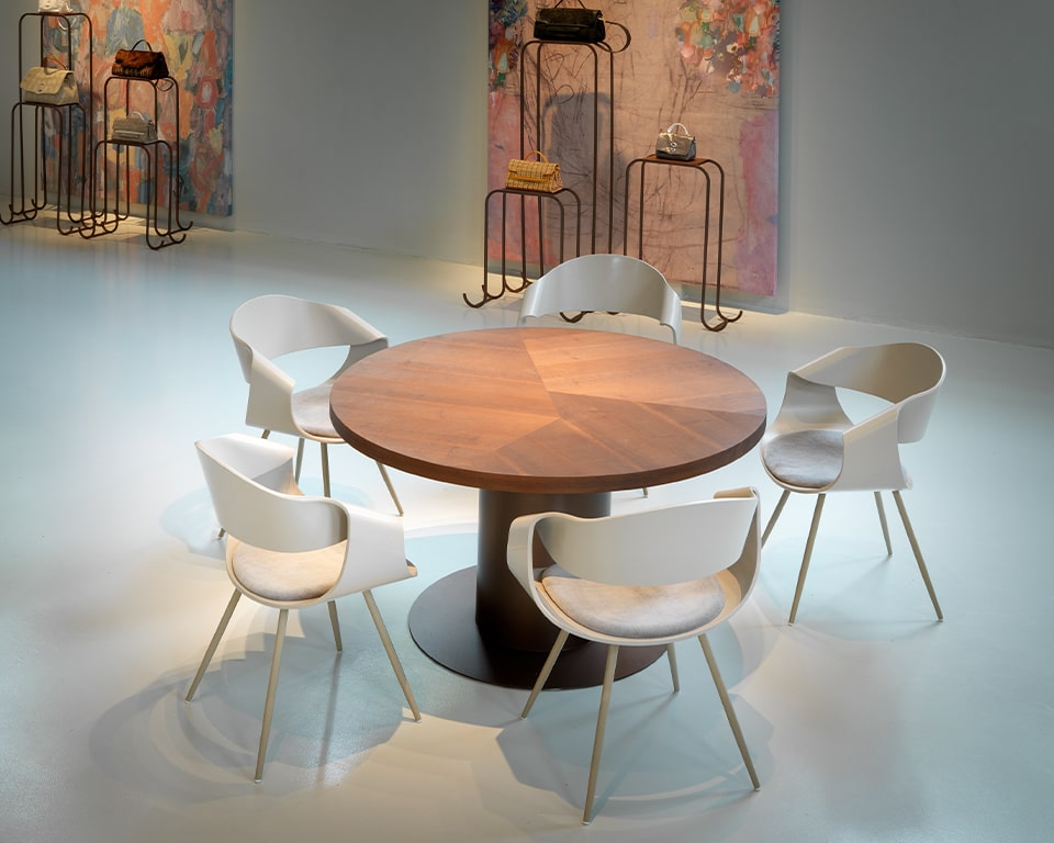 Premium quality designer meeting chairs - With white matt lacquered backs and a small upholstered seat pad with chrome legs with a round wood table