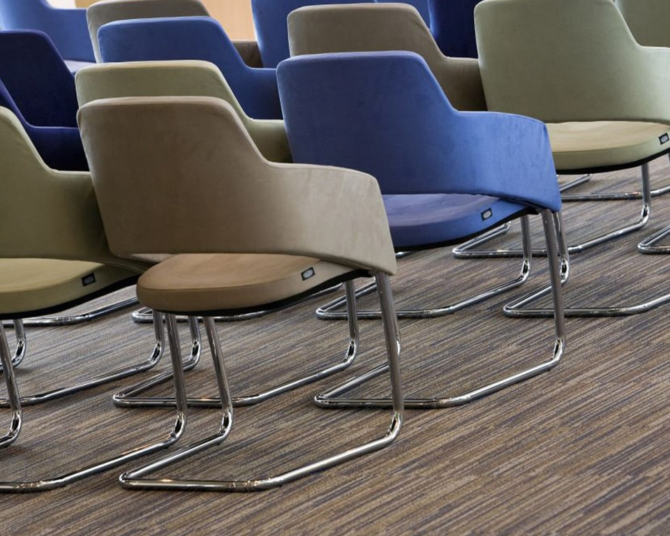The Major visitors chairs have elegant chrome frames and are excellent compact boardroom chairs shown here in fabric with side on view