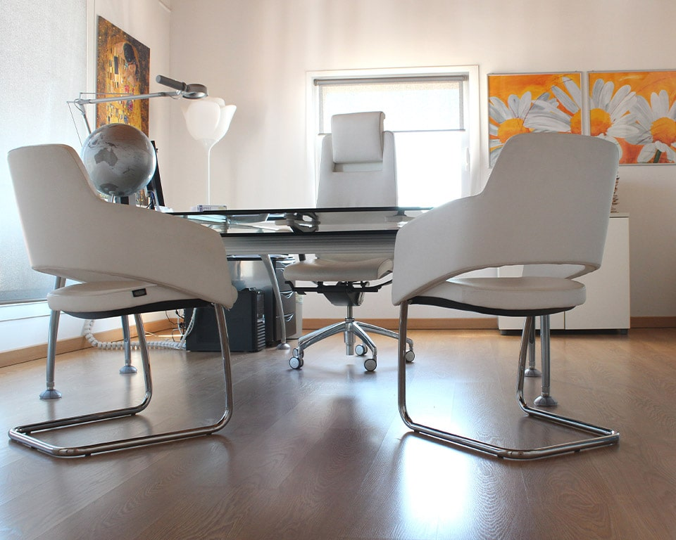 White leather meeting room chairs and white leather high back executive chair with an adjustable headrest. The visitors chairs have elegant chrome frames and are excellent compact boardroom chairs