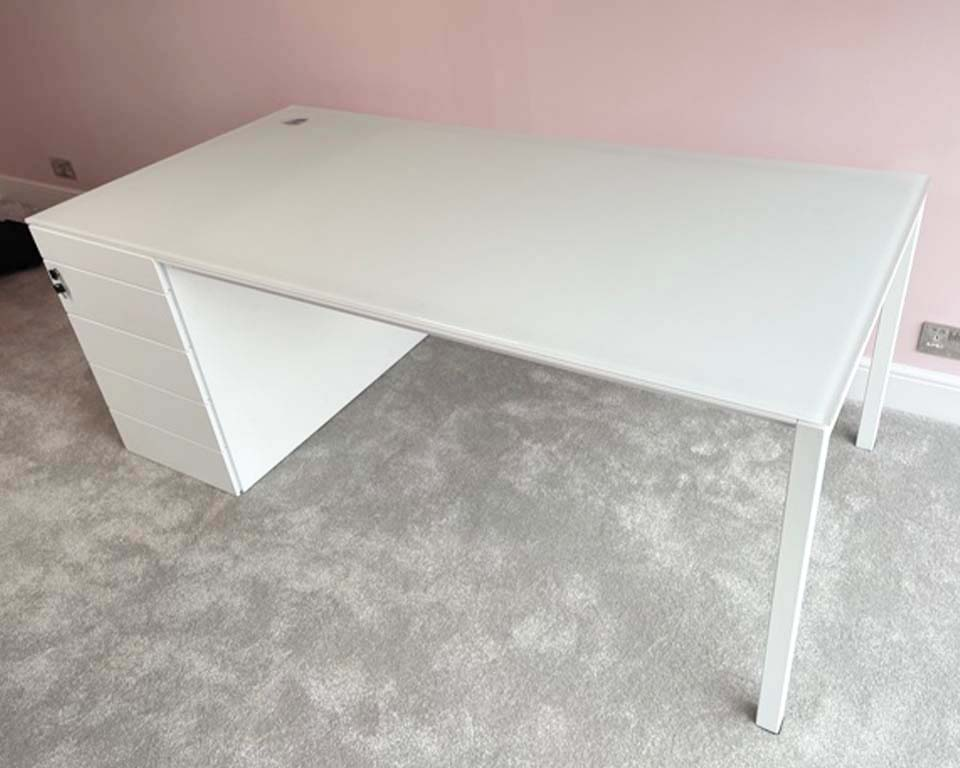 White Glass Designer desk with satin glass top and white lacquered drawers. Large executive desk 2000 x 900 with hand polished cable hole in the left hand corner above the hidden vertical cable management .