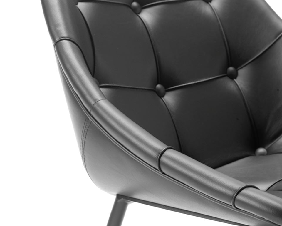 Stylish high quality occasional chairs from Sitia . These designer chairs are ideal boardroom and dining room chairs. Select models in leather with the button upholstery detailing