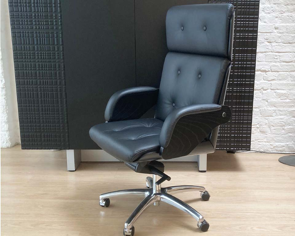 Top quality Italian Executive chair in leather and black ash wood. Buttoned real leather upholstery. High back CEO chair shown in black leather and black ash wood.
