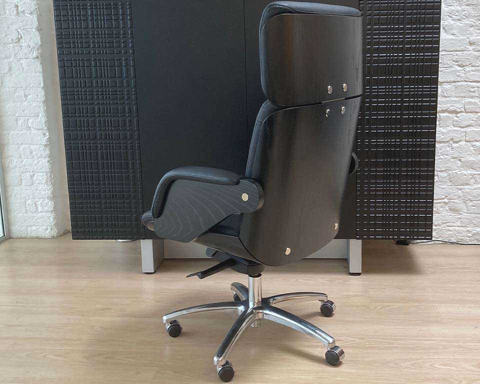 High quality Italian Executive office chair in black leather and black ash wood. Buttoned real leather upholstery. High back CEO chair shown in black leather and black ash wood.