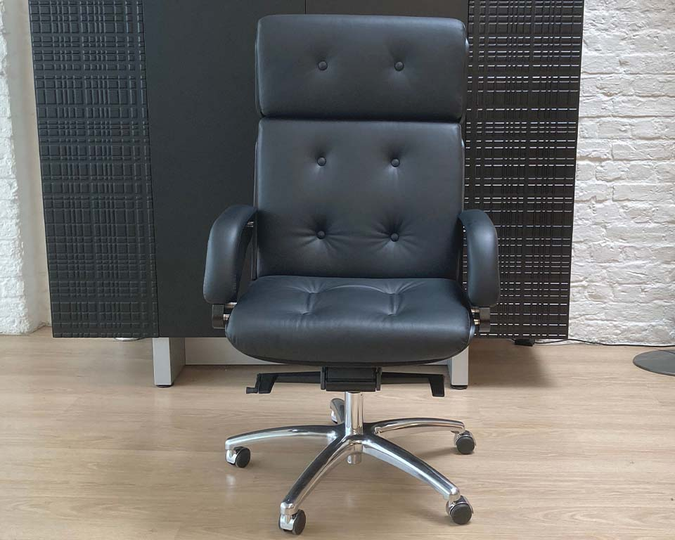 Premium high quality Italian Executive chair in real Italian leather and black ash wood frame. Buttoned real leather upholstery. High back CEO chair shown in black leather and black ash wood.Die cat aluminium 5 star base and castors.