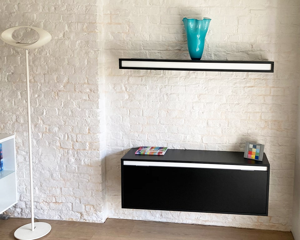 Stylish High end Wall mounted shelves and storage cupboards. These Black lacquered shelves have elegant contrasting horizontal bands in white