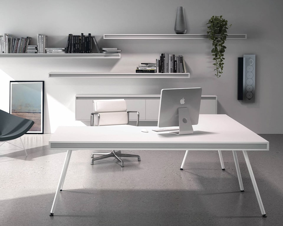 Modern White Executive desk with White legs - High quality Italian executive office desk with hidden cable management. Shown here with matching wall mounted shelves and cupboards. Finished nicely with a White leather executive chair