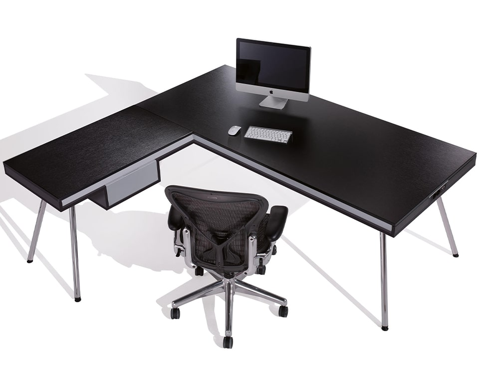 Premium Quality Modern Black Wood Desk for Executive offices - Modern executive office L shaped desk with a black ash wood top and matt white lacquered horizontal bands. Stylish chrome legs and a small personal drawer.