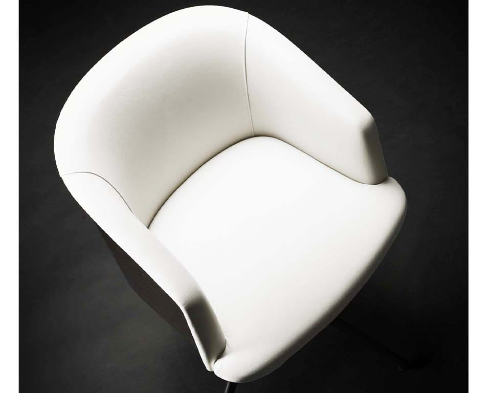 Rica is a high end fixed height boardroom chair. Upholstered in white leather with the outer shell in real wood.