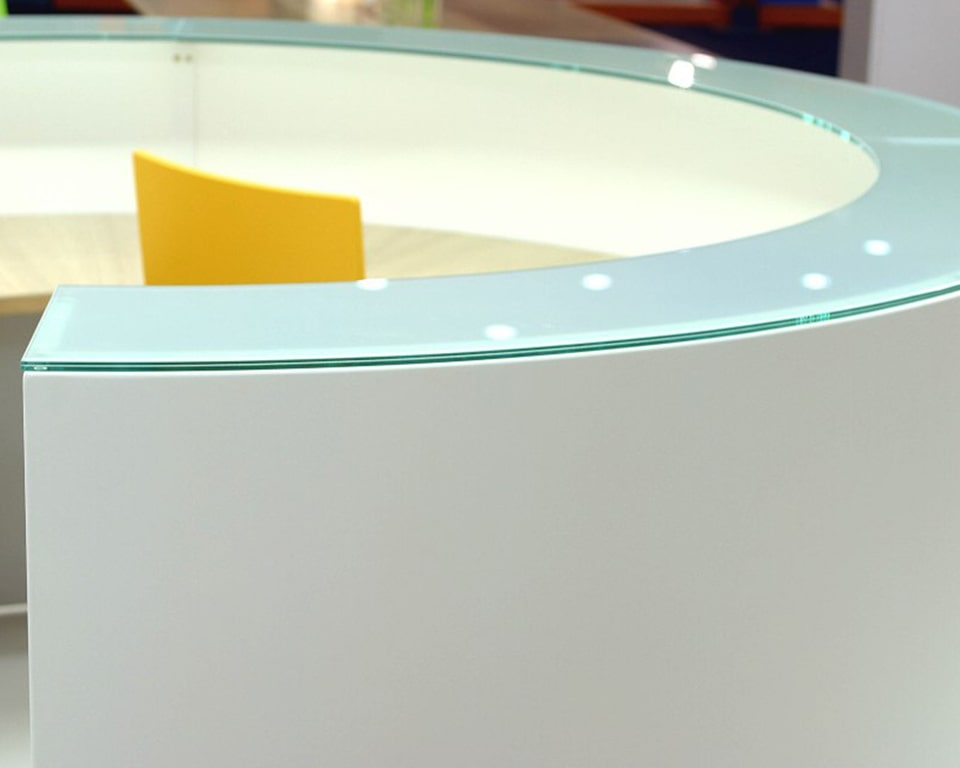 White Reception desk with opaline glass counter tops- Modular reception desk design to included curved,straight and DDA modules