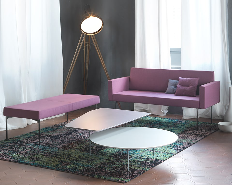 High end reduced depth office and reception area and sofa shown with white lovers coffee table