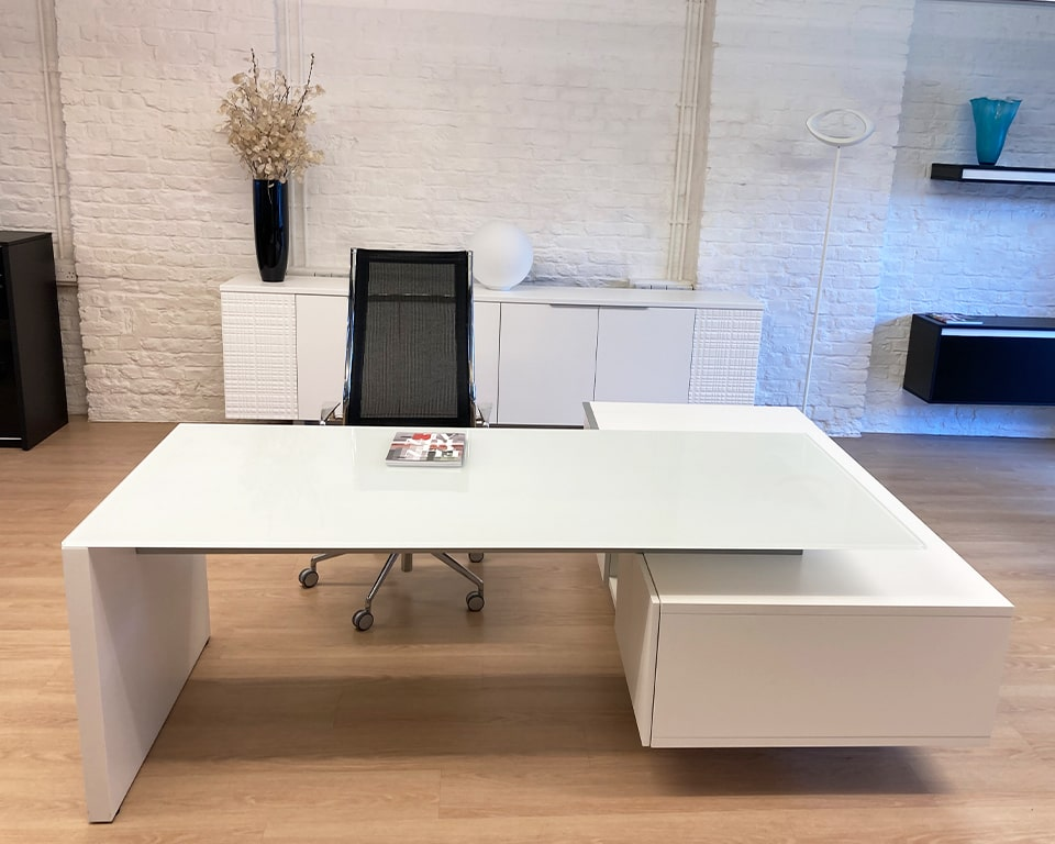 Designer glass desks -High quality large executive desk-White glass executive desk with white lacquered lowered side return. Matching matt white lacquered sideboard all accentuated by a stylish Havana executive office chair.