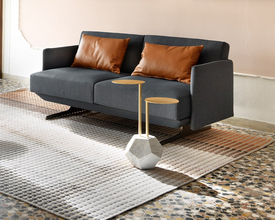 High quality Italian side tables with a white marble base and two coffee table heights in gold lacquered finish - shown here with Hugo two seat Italian sofa and PILLOWS cushions