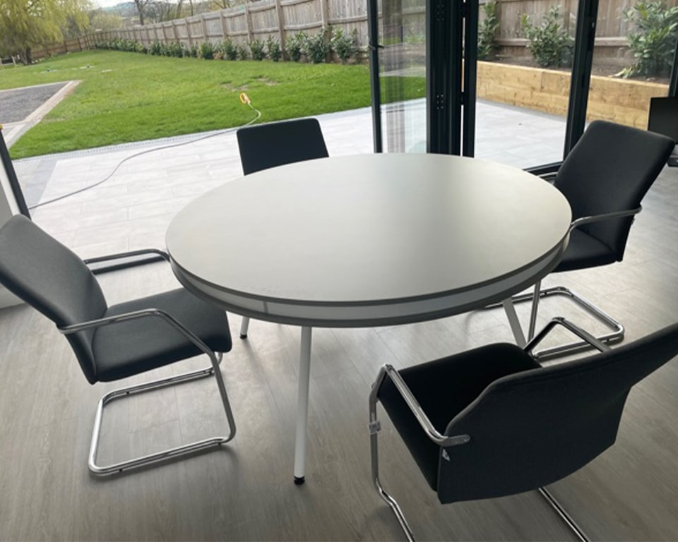 Large ON round designer meeting table 1500 mm in diameter with Tempo cantilever chairs