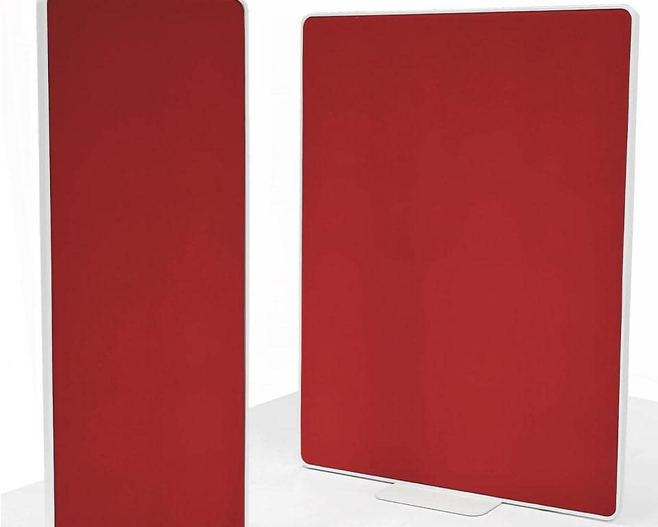 Free standing office divider screens in white with removable panels in matt lacquered. fabric or clear perspex. Shown here in red fabric with white steel frame