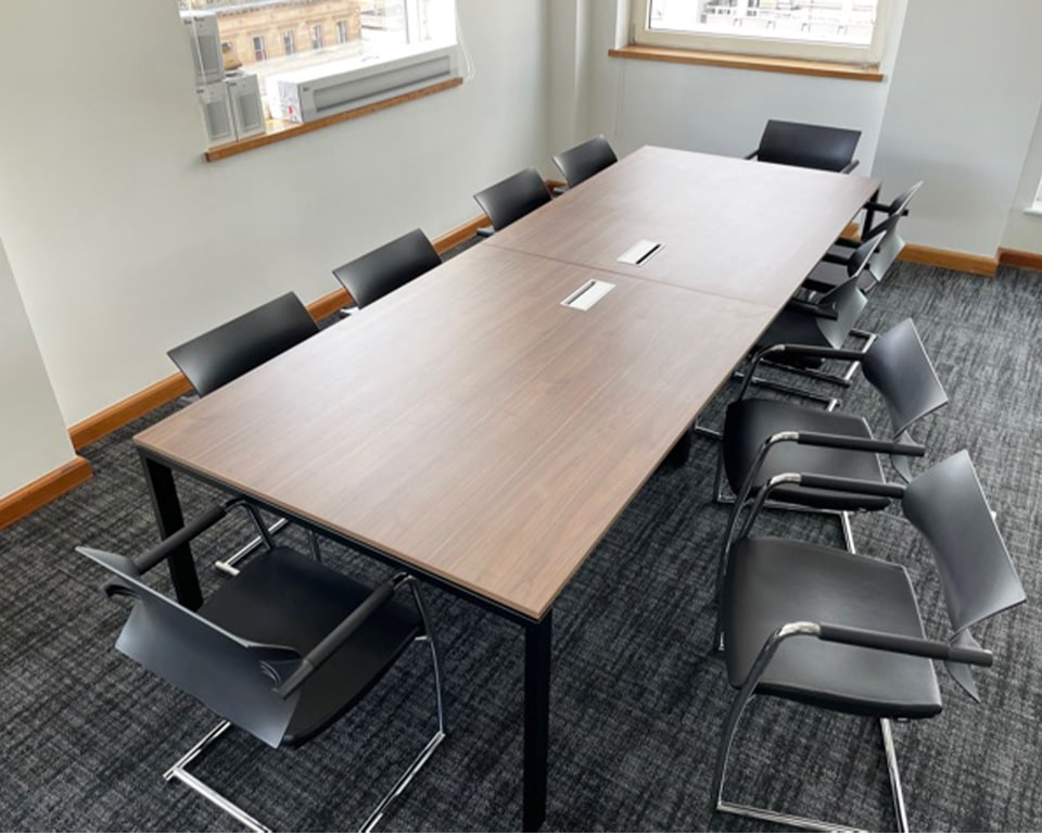 Modular boardroom table in Canaletto Walnut with black frame. Includes cable management. Available in a number of sizes but shown here 3200 x 1200 with 10 Are Jr cantilever chairs with a chrome frame and black upholstered seat and black panel