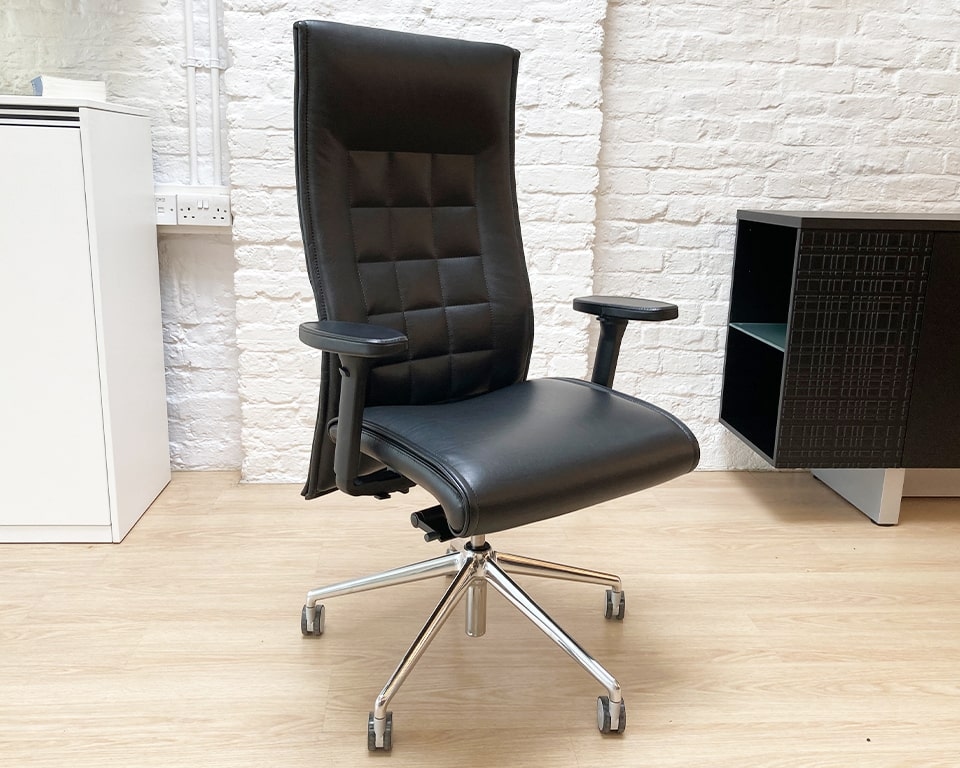 Black leather executive chair with leather height adjustable arms- High quality fully adjustable Italian executive chair with quilted back panel design. Full ergonomic features of a task chair in an executive office chair design