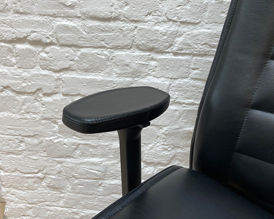Detail of the black leather arm pads on this exceptional high end designer office chair for executives and home offices