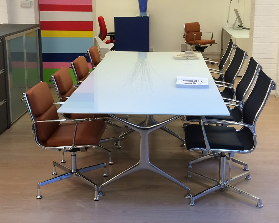 GLASS TOP BOARDROOM TABLE - high quality Italian boardroom tables in white glass , black glass or clear glass tops and die cast aluminium legs in polished, white or black shown with Havana mini boardroom chairs in black leather and black mesh and Tan leather boardroom chairs