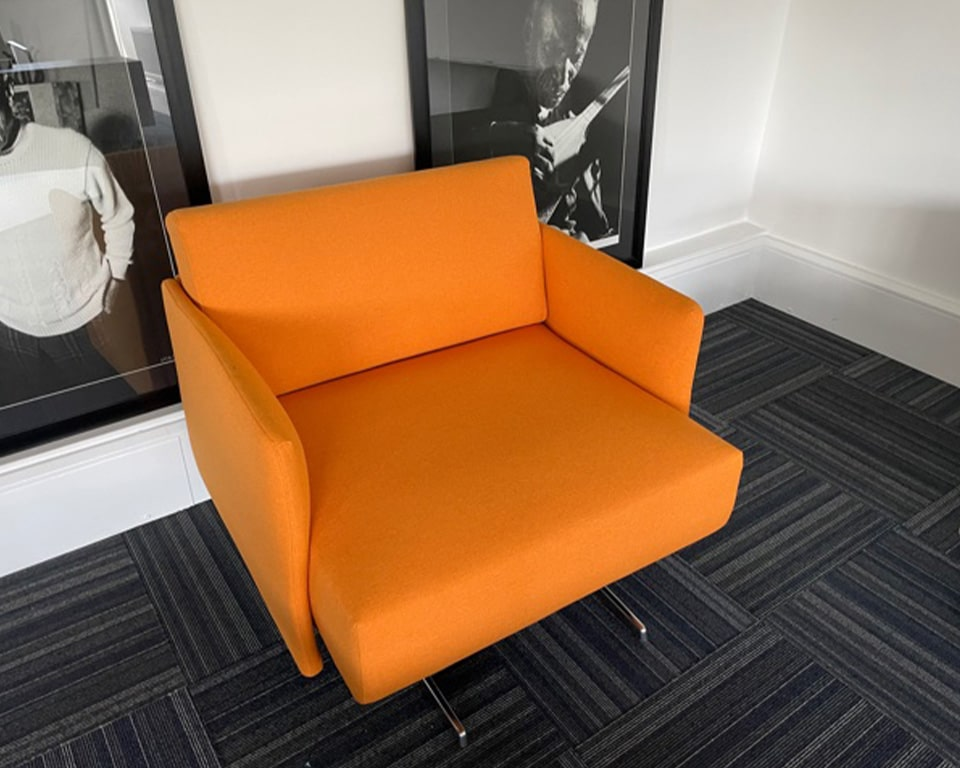 High quality Italian armchairs - Shown here in orange fabric with die cast aluminium frame.