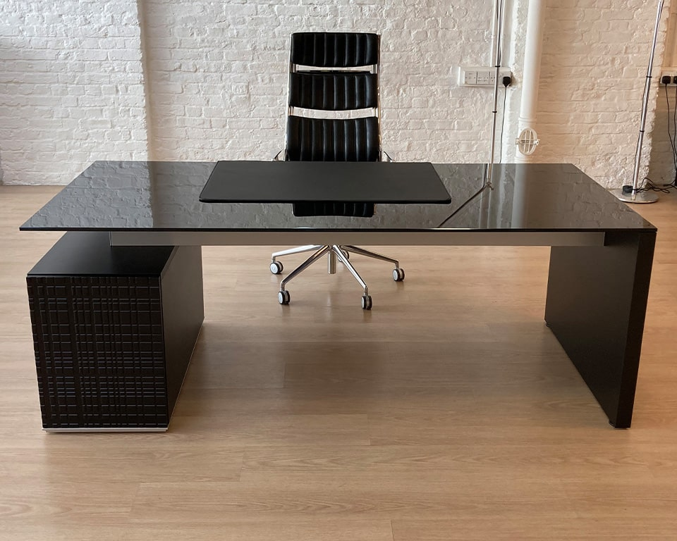BLACK GLASS EXECUTIVE DESK 2000 x 900 - Stylish rectangular or L - shaped black glass desks with matt black lacquered drawers shown with a high back havana chair and desk pad in matching black leather