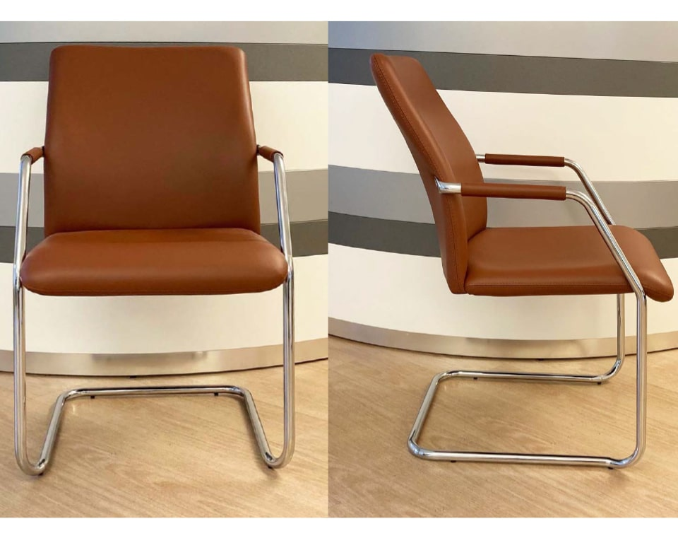 HIGH QUALITY CANTILEVER OFFICE CHAIRS in Tan leather ,other leather colours are available as standard, Chrome arms with leather arm pads.Chrome cantilever frame with arms and leather arm pads.Stackable up to 4 pieces it is an ideal visitors chair and meeting room chair