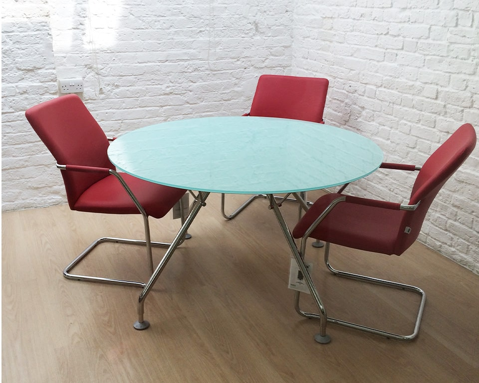 LUXURY CANTILEVER OFFICE CHAIRS in red leather ,other leather colours are available as standard, Chrome arms with leather arm pads.Chrome cantilever frame with arms and leather arm pads.Stackable up to 4 pieces it is an ideal visitors chair and meeting room chair as shown here around a round frosted glass meeting room table with matching chrome legs