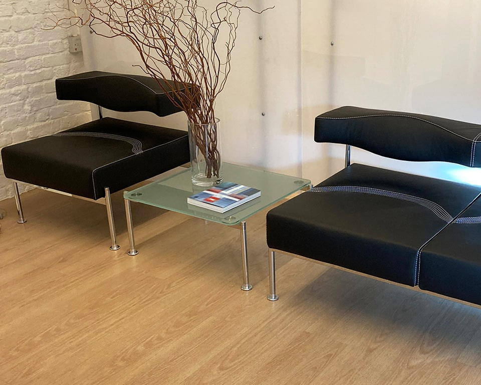 High end Luxury reception office seating modules and matching glass coffee tables- Momo is a stylish designer seating range made in Italy by Sitia and designed by Fiorenzo Dorigo