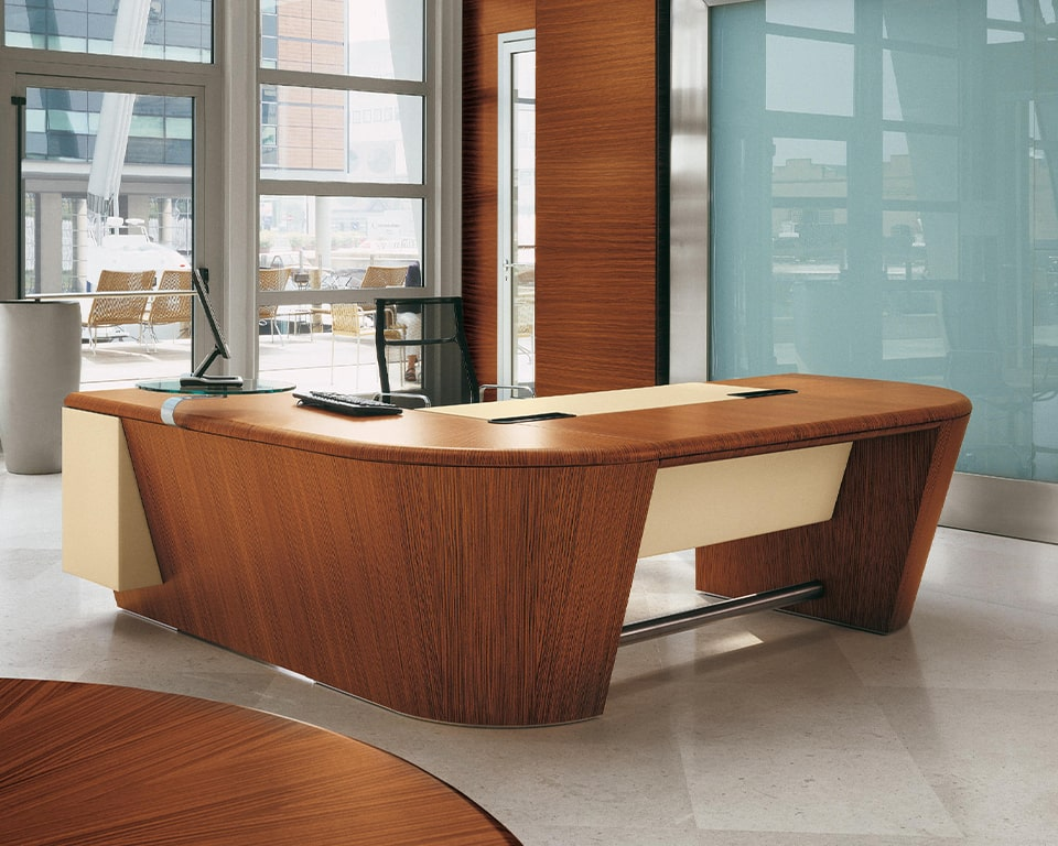High quality L - shaped executive desk in real wood - Extra L arge L shaped executive desks with storage and wire management included. Leather inlaid writing area and leather modesty panel. Shown here in Zebra wood with a Charles eames Aluminium group executive chair