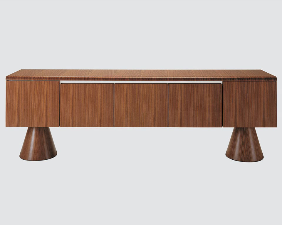 High - end contemporary executive sideboards in real wood . Designed to match 16 Gradi executive desks they are ideal on their own in your living rooms. This stylish credenza is shown in dark oak wood and is raised off the floor by two designer conical pedestal legs. 5 door all wood version with soft close doors.
