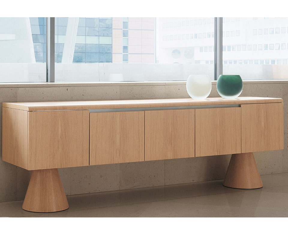 High quality modern executive sideboards in real wood . Designed to match 16 Gradi executive desks they are ideal on their own in your living rooms. This stylish credenza is shown in bleached oak wood and is raised off the floor by two designer conical pedestal legs.