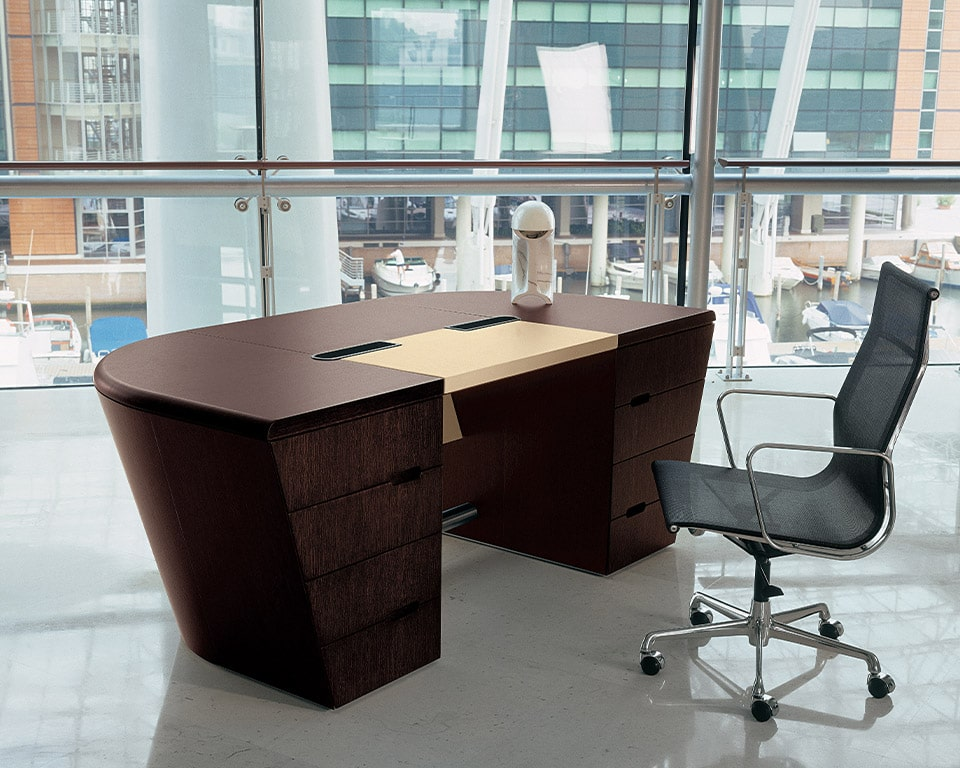 High quality modern Double pedestal executive desk in real wood - Shown here in the extra large 2500 wide version with a leather writing area and modesty panel. Shown with a high end aluminium group by Charles Eames.