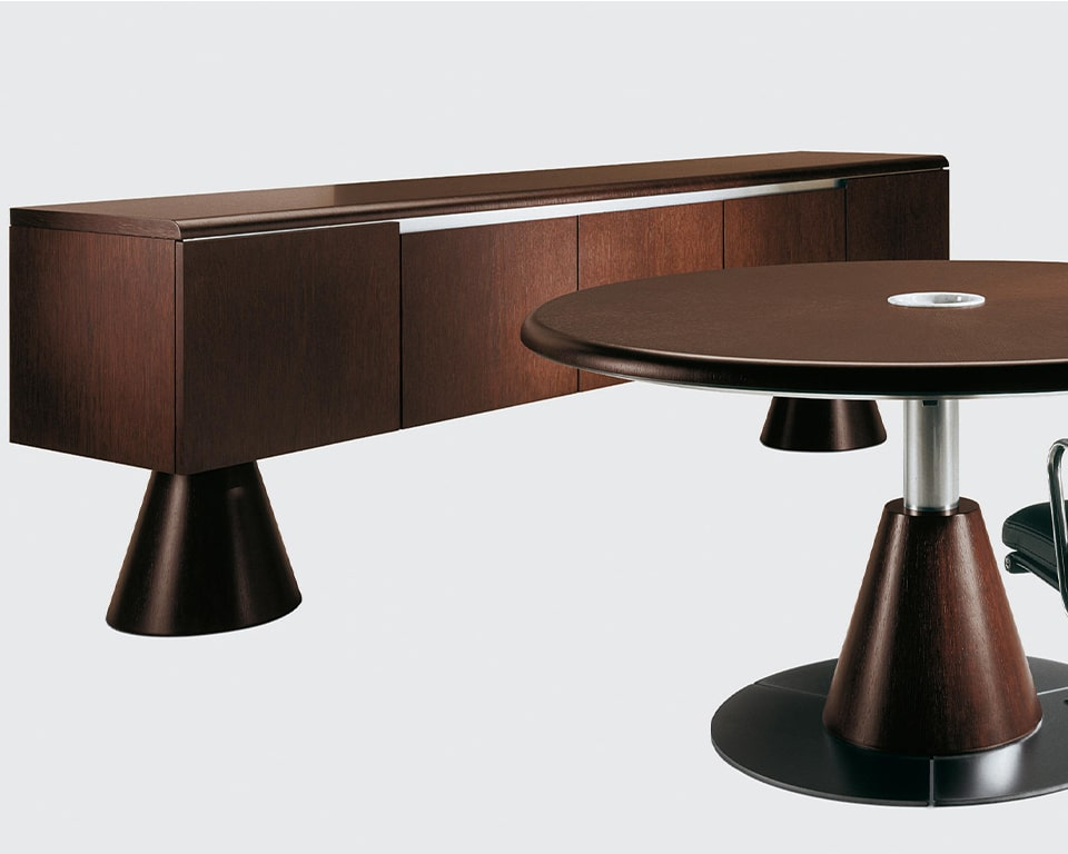 Luxury large round boardroom table in real wood. Shown here in dark oak wood but also available in dark oak and bleached oak. Other wood finishes available on request. Large designer board room tables 100% made in Italy. Matching dark oak credenza to match your round or oval boardroom tablees. These can also be used with Taiko , Tau and Edoc executive desks
