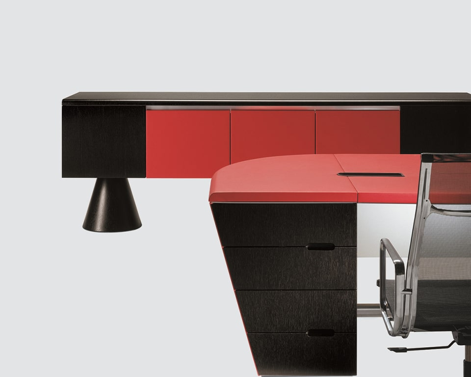 Luxury quality contemporary executive sideboards in real wood . Designed to match 16 Gradi executive desks they are ideal on their own in your living rooms. This stylish credenza is shown in dark grey oak wood and is raised off the floor by two designer conical pedestal legs. 5 door version with 3 doors in red leather soft close doors.