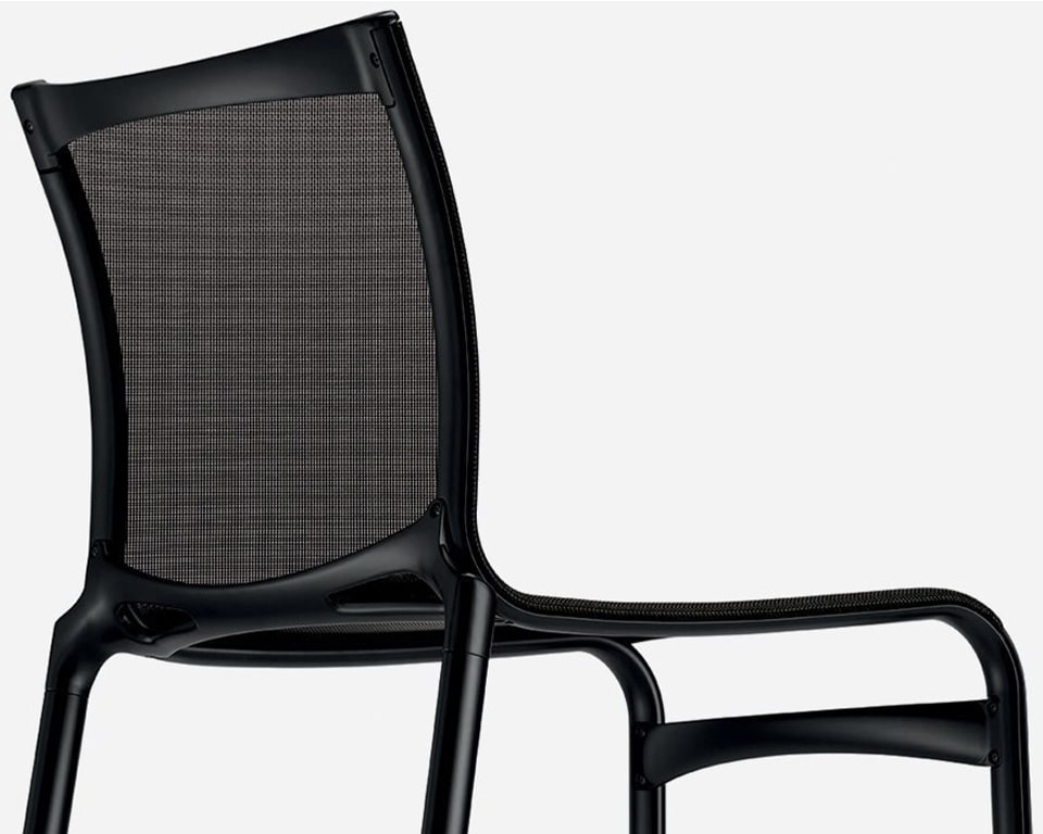 Luxury high quality Mesh dining and meeting chairs - Big Frame 44 by Alias design are available with or without arms and shown here in all black version without arms. Premium High - end Meeting room or dining room chairs from Italy