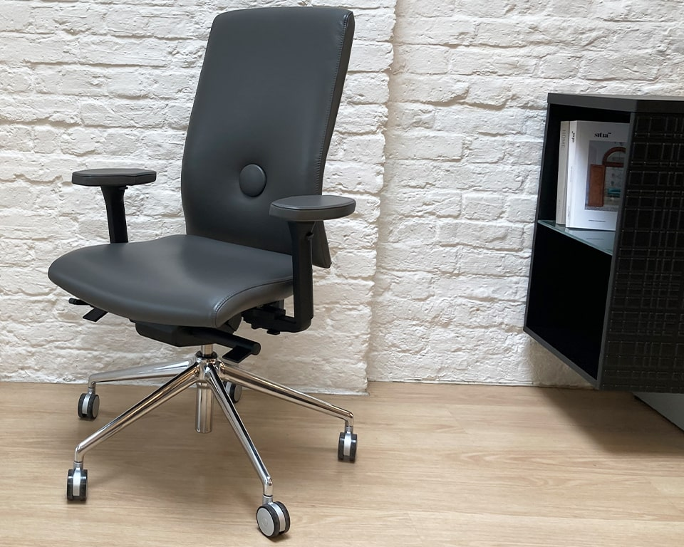 Luxury office chairs-Dark grey leather Executive task chair with fully adjustable arms. The arm pads are lalso upholstered in leather. Die cast polished aluminium base and castors. Seat depth adjustment. Gas lift height adjustment. Tilt. Height adjustable back for ergonomic support