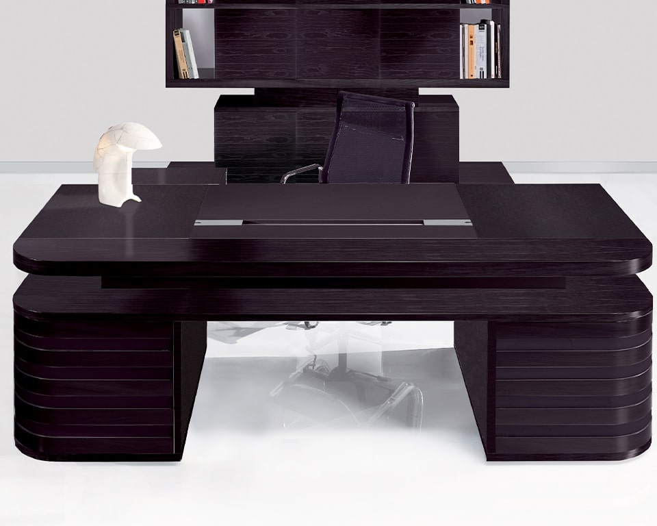 Contemporary double pedestal partners executive desk in dark grey oak wood with leather inlaid writing pad . A matching leather modesty panel can be added - High quality traditional Italian craftsmanship . shown with matching Edoc executive bookcase storage