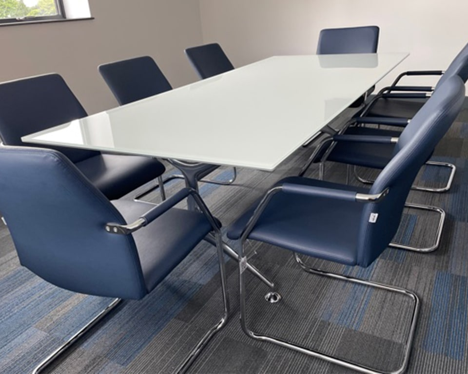 Luxury glass boardroom tables -White Glass boardroom table rectangular shape with die cast aluminium legs 2400 x 1050 size with blue leather tempo cantilever meeting room chairs - stackable