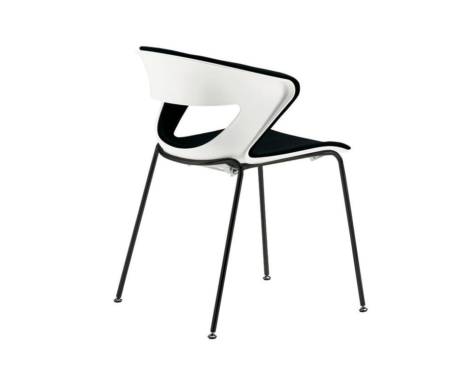 luxury quality Stackable upholstered dining chairs - Designer meeting room or cafe style chairs with polypropylene seat and back in white with a stackable black 4 leg base - High quality Italian meeting room and dining chairs in many colours with a black fabric seat detail view of the outer back panel