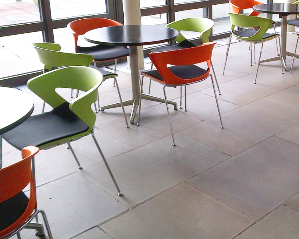 luxury high quality upholstered Stacking chairs - Designer meeting room or cafe style chairs with polypropylene seat and back in red and green with a stackable chrome 4 leg base - High end Italian meeting room and dining chairs in many colours with a black fabric seat