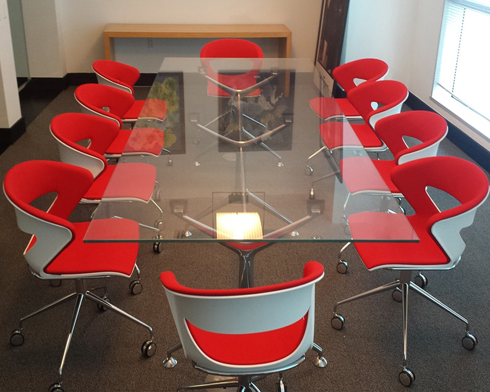 Designer meeting room chairs with polypropylene seat and back in white and fully upholstered in red fabric with a chrome 4 spoke base and castors - High quality Italian meeting room chairs with swivel and height adjustment