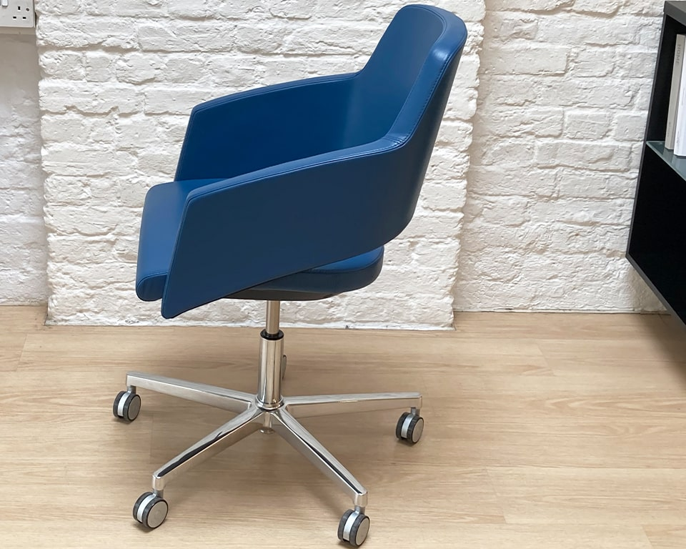 Small compact home office chair- high - end small designer swivel chair with a tilt mechanism. gas lift seat height adjustment. Die cast polished aluminium 5 star base and castors. Also available without wheels. Shown in G range Blue Italian leather