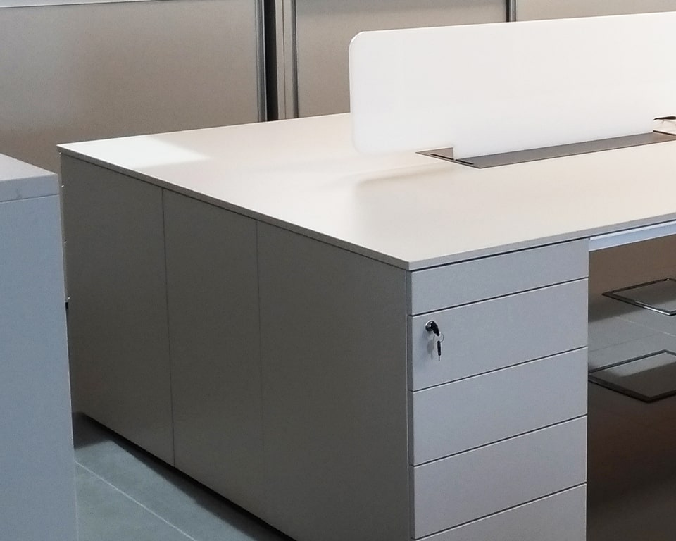 Luxury High End executive Bench Desks with Pedestals and cable management - Shown here as a 2 position double desk 1600 x 1600 with 2 perspex screens and lay in wire management with top access - Shown in White laminate with white perspex screen dividers
