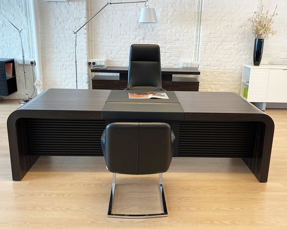 Luxury high quality CEO executive desk in Ebony- High end 2600 x 1000 extra large executive desk with leather inlaid desk top and modesty panel. Shown here with black leather Darwin executive office chairs.