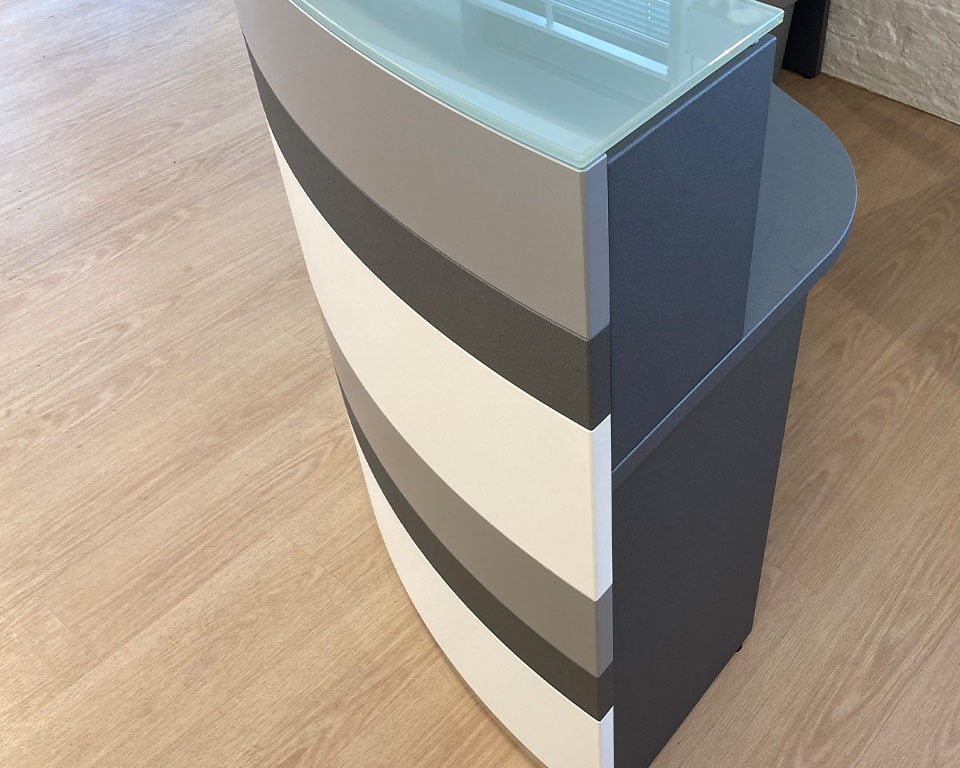 Luxury quality Designer reception desks - Twist is an elegant modular range of high - end reception desks with 6 horizontal colour bands in a choice of at least 15 modern matt lacquered colours. These reception counters are available in any sizes and shapes suitable for a single user or multiple users