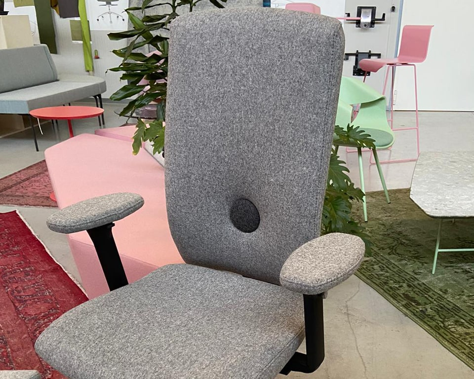 Luxury Designer operators chair in grey fabric - Upholstered height adjustable 4 d arms. This is an executive operators chair that is ergonomically comfortable for long sitting durations. A stylish designer chair for computer operators at home or in the office.